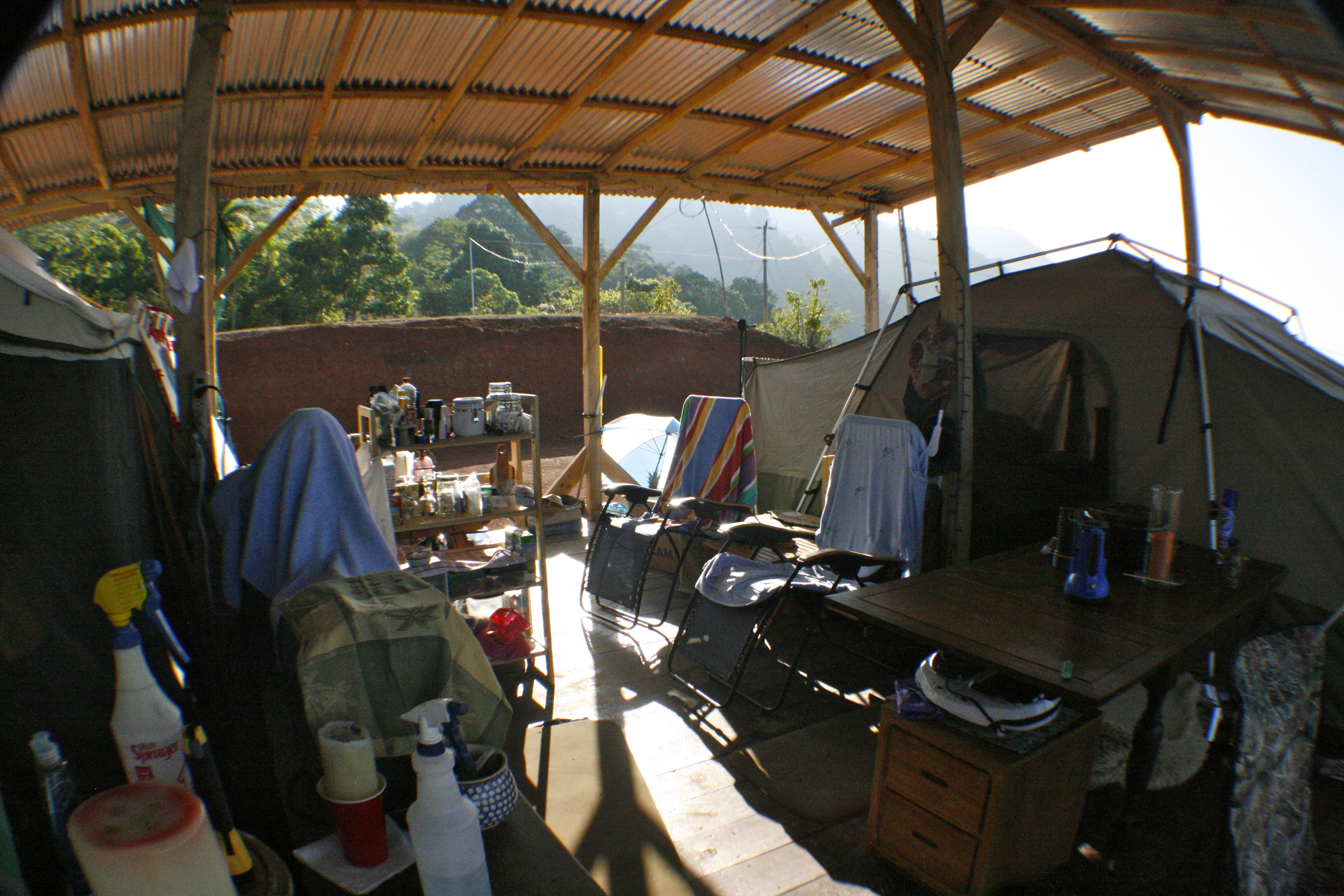 Inside before plastic, tarps, wood, tin and anything else I could nail or tie onto the structure, including umbrellas.